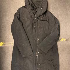 Zwarte jas, zoals gemeld door Grand Hotel Amrath Kurhaus met iLost