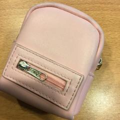 Roze portemonnee op naam van Luckert, as reported by Gemeente Amsterdam using iLost