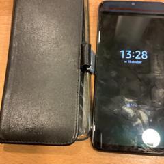 Mobiel samsung zwart in hoesje, come riportato da Gemeente Amsterdam utilizzando iLost