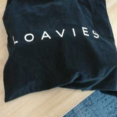 Zwart linnen tasje met inhoud, zoals gemeld door Connexxion Haarlem AML met iLost