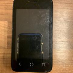 Zwarte Alcatel onetouch telefoon, as reported by Qbuzz / U-OV using iLost