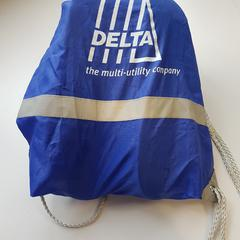 Blauwe nylon tas met opschrift DELTA, as reported by Connexxion Zeeland using iLost