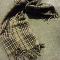 sjaal, zoals gemeld door Internationaal Theater Amsterdam met iLost