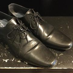 Black leather shoes, as reported by Conscious Hotel Museum Square using iLost