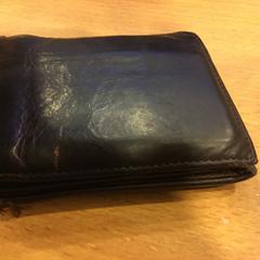 Zwarte portemonnee op naam van Kooij, as reported by Gemeente Amsterdam using iLost