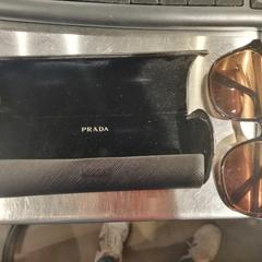 Prada sunglasses + case, as reported by MEININGER Hotel Bruxelles Gare du Midi using iLost