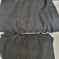 Jumpsuit and blouse, zoals gemeld door The Tire Station Hotel met iLost