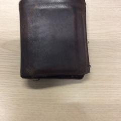 Bruine portemonnee op naam van M. Zwama.