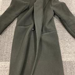 Zwarte damesjas, zoals gemeld door Jaarbeurs met iLost