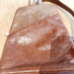 Bruine handtas, zoals gemeld door Conscious Hotel Westerpark met iLost