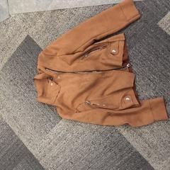 Bruine suede jas, zoals gemeld door Jaarbeurs met iLost